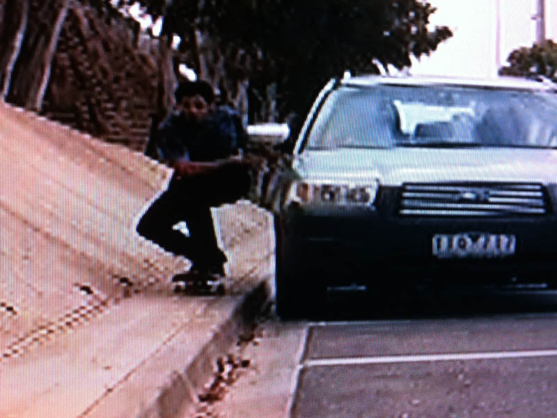 Skater towed by car