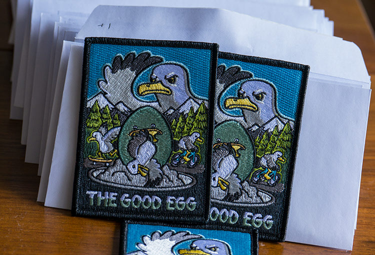 the good egg embroidered patch and all the envelopes ready for shipping