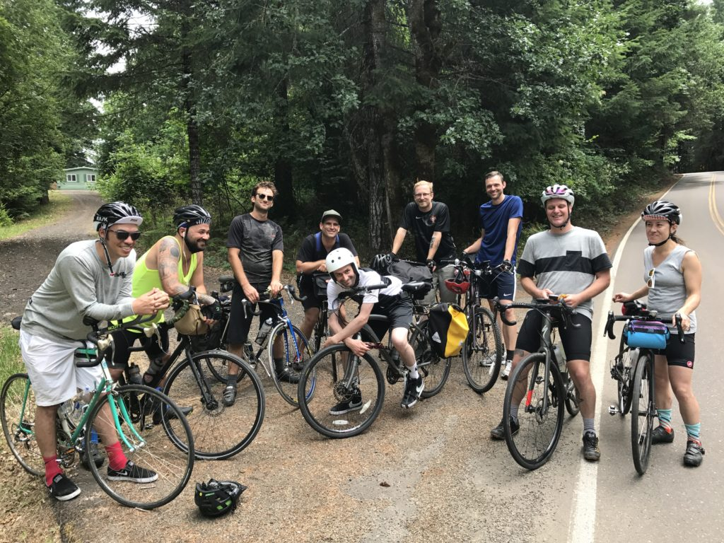 benson, jonah, quinn, cardiel, rattray, marty, oleg, brent, and molly all with bikes on the road
